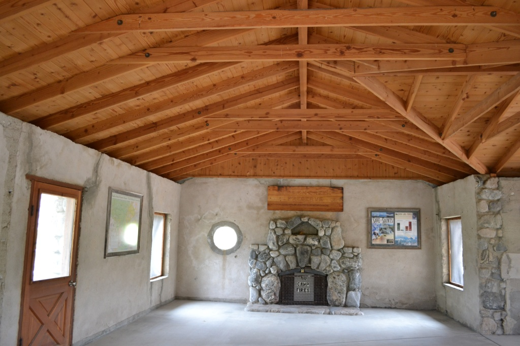 vaulted ceiling & fireplace in stone cabin